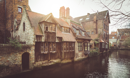 Panoramic view of the historic city center of Brugge with traditional houses in beautiful golden evening light at sunset with retro vintage Instagram style filter effect in summer, Flanders, Belgium Stock Photo