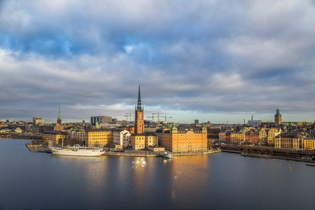 Panoramic view of famous Stockholm city center with historic Riddarholmen in Gamla Stan old town district in beautiful morning light at sunrise with blue sky and clouds, Sodermalm, central Stockholm, Sweden Stock Photo