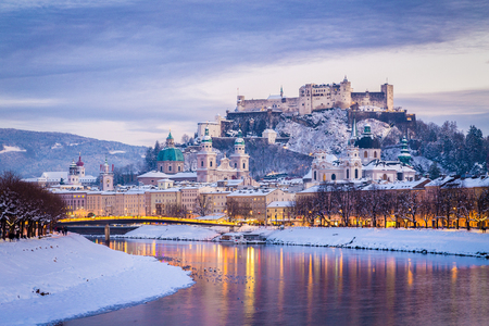 Classic view of the historic city of Salzburg with famous Festung Hohensalzburg and Salzach river illuminated in beautiful twilight during scenic Christmas time in winter, Salzburger Land, Austria Stock Photo - 97156376