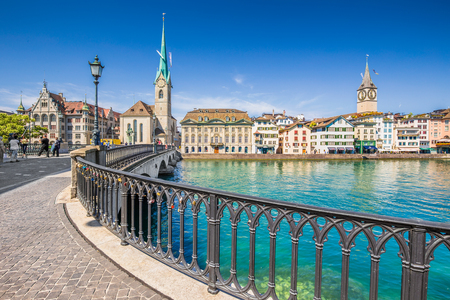 Historic city center of Zurich with famous Fraumunster Church and Munsterbucke crossing river Limmat, Canton of Zurich, Switzerland Editorial