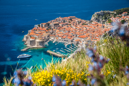 Panoramic aerial view of the historic town of Dubrovnik, one of the most famous tourist destinations in the Mediterranean Sea, from Srt mountain on a beautiful sunny day in summer, Dalmatia, Croatia Stock Photo