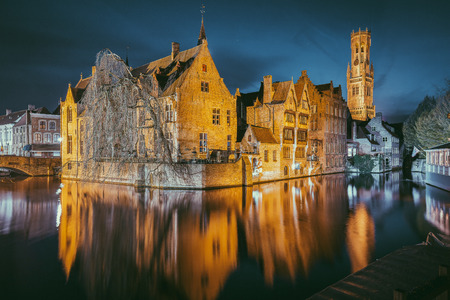 Classic postcard view of the historic city center of Brugge, often referred to as The Venice of the North, with famous Rozenhoedkaai illuminated in beautiful twilight, West Flanders province, Belgium 写真素材 - 98316730