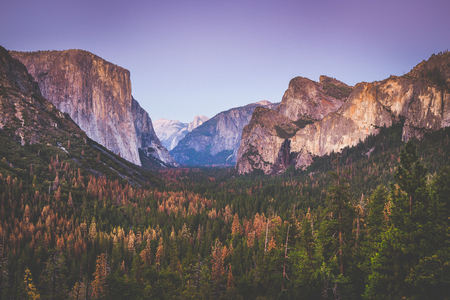 Classic Tunnel View of famous Yosemite Valley in beautiful post sunset twilight during blue hour at dusk in summer, Mariposa, County, California, USA