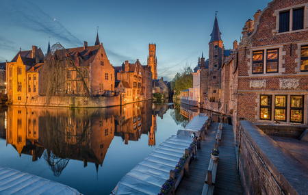 Classic postcard view of the historic city center of Brugge, often referred to as The Venice of the North, with famous Rozenhoedkaai illuminated in beautiful twilight, West Flanders province, Belgium 写真素材 - 96049471