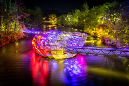 Beautiful panorama view of famous Grazer Murinsel, an artificial floating island in the middle of Mur river illuminated at night, Graz, Styria region, Austria Stock Photo