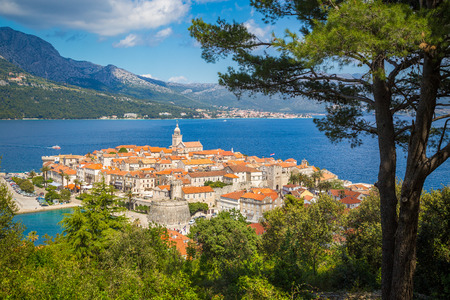 Beautiful view of the historic town of Korcula on a beautiful sunny day with blue sky and clouds in summer, Island of Korcula, Dalmatia, Croatia