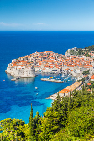 Panoramic aerial view of the historic town of Dubrovnik, one of the most famous tourist destinations in the Mediterranean Sea, from Srt mountain on a beautiful sunny day in summer, Dalmatia, Croatia Stok Fotoğraf