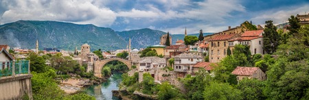 Panoramic view of the historic town of Mostar with famous Old Bridge (Stari Most), on a rainy day with dark clouds in summer, Bosnia and Herzegovina