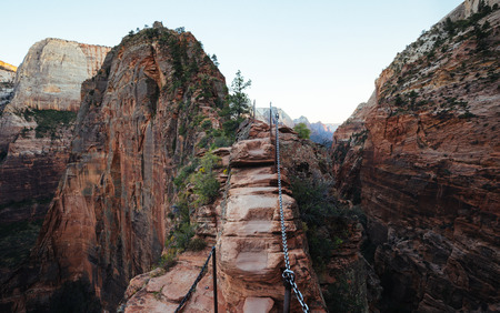 Panoramic view of famous Angels Landing hiking trail overlooking scenic Zion Canyon in beautiful post sunset evening twilight in summer, Zion National Park, Springdale, southwestern Utah, USA