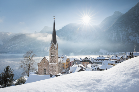 Panoramic view of famous Hallstatt lakeside town during winter sunrise on a beautiful cold sunny day at Christmas time, Salzkammergut, Austria