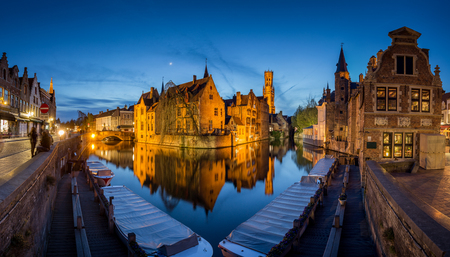 Classic postcard view of the historic city center of Brugge, often referred to as The Venice of the North, with famous Rozenhoedkaai illuminated in beautiful twilight, West Flanders province, Belgium Stok Fotoğraf