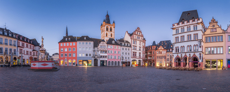 Panoramic view of the historic city center of Trier with famous Hauptmarkt market square and St. Gangolf church in beautiful post sunset twilight at dusk in summer, Rheinland-Pfalz, Germany