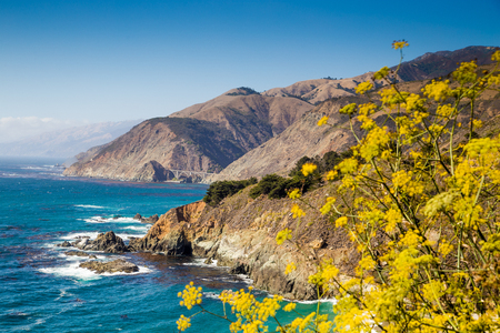 Scenic view of the rugged coastline of Big Sur with Santa Lucia Mountains and Big Creek Bridge along famous Highway 1 in beautiful golden evening light at sunset in summer, California Central Coast, U 写真素材