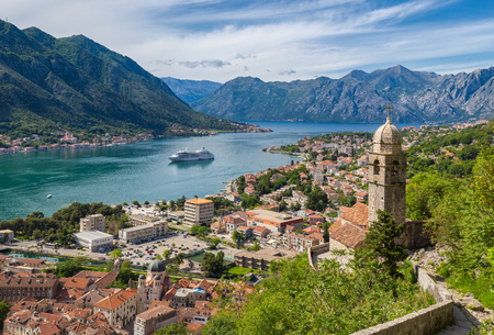 Classic panorama view of the historic Church of Our Lady of Remedy overlooking the old town of Kotor and world-famous Bay of Kotor, Montenegro, southern Europe.