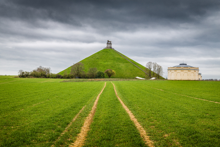 Panorama view of famous Lions Mound (Butte du Lion) memorial site, a conical artificial hill located in the municipality of Braine-lAlleud comemmorating the battle  on a moody day with dark clouds i