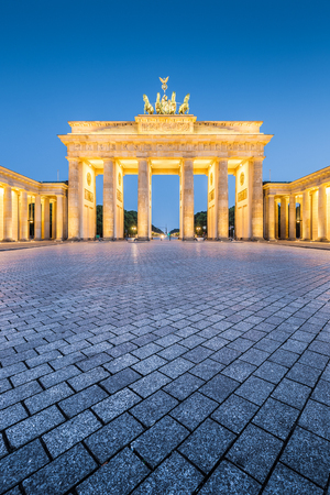 Classic vertical view of historic Brandenburg Gate, Germanys most famous landmark and a national symbol, in post sunset twilight during blue hour at dusk in summer, central Berlin, Germany Stock fotó