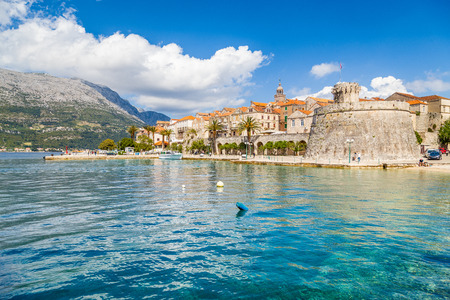Beautiful view of the historic town of Korcula on a beautiful sunny day with blue sky and clouds in summer, Island of Korcula, Dalmatia, Croatia 免版税图像 - 100156315