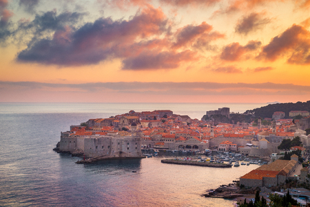 Panoramic aerial view of the historic town of Dubrovnik, one of the most famous tourist destinations in the Mediterranean Sea, in beautiful golden evening light at sunset, Dalmatia, Croatia 免版税图像