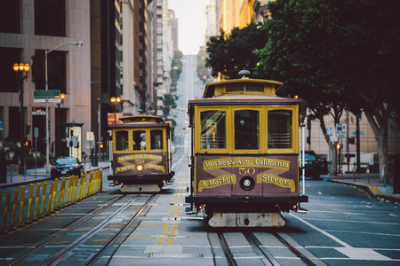 Classic panorama view of historic San Francisco Cable Cars on famous California Street at sunset with retro vintage filter effect, central San Francisco, California, USA 에디토리얼