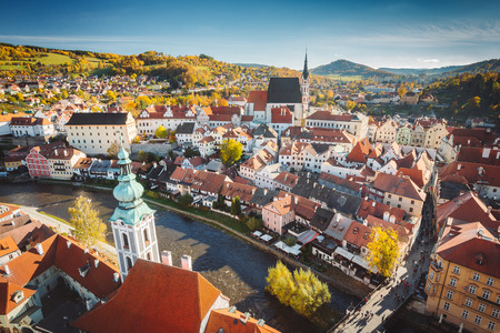 Panoramic aerial view of the historic city of Cesky Krumlov with famous Cesky Krumlov Castle, in beautiful golden evening light at sunset, Czech Republic