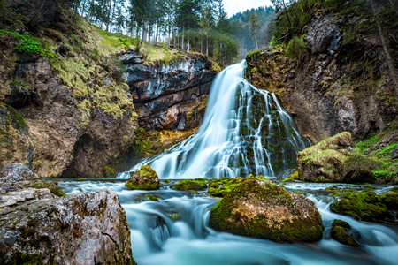 Beautiful view of famous Gollinger Wasserfall with mossy rocks and green trees on a moody in springtime, Golling, Salzburger Land, Austria Stock fotó