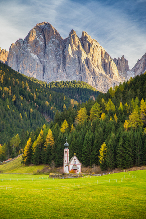 Beautiful view of historic Church of St. Johann of Nepomuk with famous Odle Group mountain peaks in the Dolomites in beautiful evening light at sunset, South Tyrol, Italy 版權商用圖片