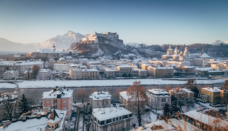 Classic view of the historic city of Salzburg with famous Hohensalzburg Fortress and Salzach river in scenic morning light at sunrise on a beautiful cold sunny day in winter, Salzburger Land, Austria Stock Photo