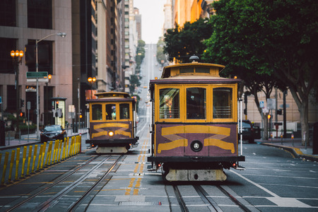 Classic panorama view of historic San Francisco Cable Cars on famous California Street at sunset with retro vintage, central San Francisco, California, USA