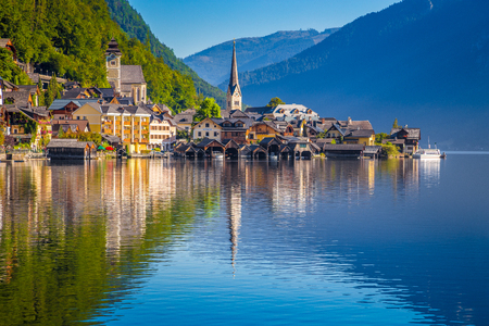 Classic postcard view of famous Hallstatt lakeside town in the Alps in scenic golden morning light at sunrise on a beautiful sunny day in summer, Salzkammergut region, Austria Stock Photo