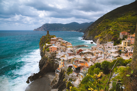 Beautiful view of Vernazza, one of the five famous fisherman villages of Cinque Terre with dramatic cloudscape at sunset in Liguria, Italy