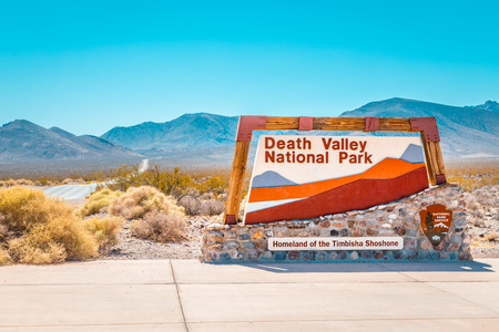 Classic view of famous Death Valley National Park entrance sign on a sunny day with blue sky in summer, California, USA