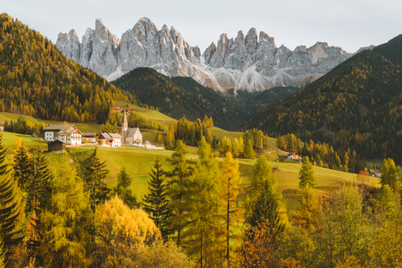 Beautiful view of idyllic mountain scenery in the Dolomites with famous Santa Maddelana mountain village in beautiful golden evening Stock Photo