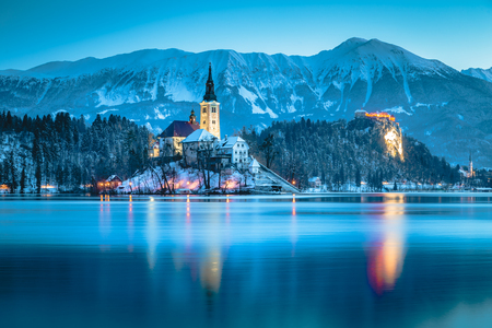 Beautiful twilight view of Lake Bled with famous Bled Island and historic Bled Castle