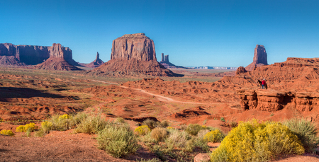 Classic panoramic view of scenic Monument Valley with horse rider at famous John Fords Point Stock fotó