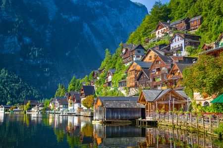 Traditional old wooden houses in famous Hallstatt mountain village at Hallstattersee lake in the Austrian Alps
