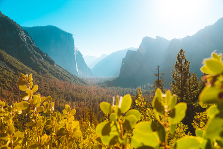 Panoramic view of famous Yosemite Valley Tunnel View in beautiful morning light at sunrise