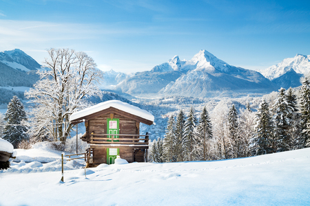 Beautiful view of traditional wooden mountain cabin in scenic winter wonderland mountain scenery in the Alps Stock Photo - 114001776