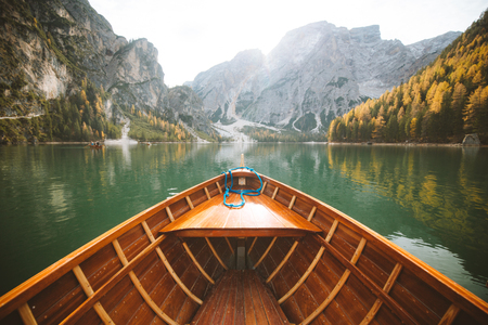 Beautiful view of traditional wooden rowing boat on scenic Lago di Braies