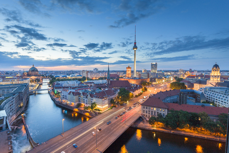Classic aerial view of Berlin skyline with famous TV tower and Spree river in beautiful post sunset twilight 写真素材