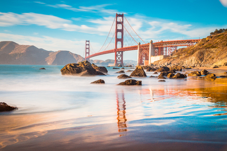 Classic panoramic view of famous Golden Gate Bridge seen from scenic Baker Beach