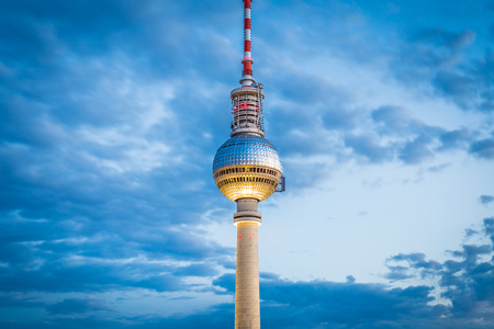 Aerial view of famous TV tower at Alexanderplatz with dramatic cloudscape in twilight