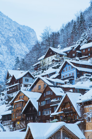 Classic postcard view of traditional wooden houses in famous Hallstatt lakeside town
