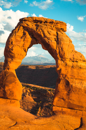 Classic panorama view of famous Delicate Arch, symbol of Utah and a popular scenic tourist attraction