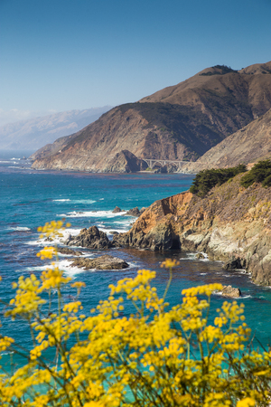 Scenic view of the rugged coastline of Big Sur with Santa Lucia Mountains and Big Creek Bridge