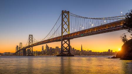 Classic panoramic view of San Francisco skyline with famous Oakland Bay Bridge illuminated Stock Photo