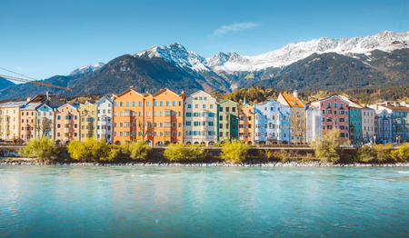 Panoramic view of the historic city center of Innsbruck with colorful houses along Inn river and famous Austrian