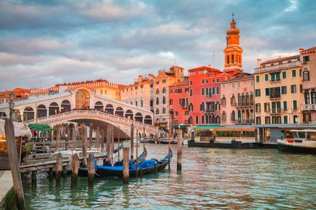 Classic panoramic view with traditional Gondolas on famous Canal Grande with famous Rialto Bridge