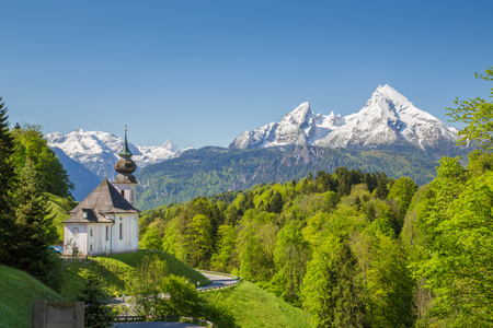 Classic view of Maria Gern pilgrimage church embedded in idyllic scenery with famous Watzmann mountain top
