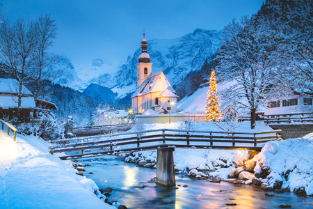 Beautiful twilight view of Sankt Sebastian pilgrimage church with decorated Christmas tree illuminated