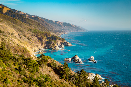 Scenic view of the rugged coastline of Big Sur with Santa Lucia Mountains along famous Highway 1 illuminated